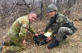 Major Simon Hawkins collecting soil with Korean military personnel in Maryang San, Korean DMZ.