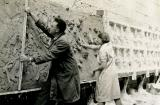Arthur Buist and Barbara Tribe  applying clay to the bas releif backing board. Courtesy Sylvia Embling archive