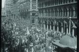 The Sun printed this photograph of a 'Carnival of Peace' where thousands gathered in Martin Place. Allies' flags hang from poles edging the public space