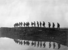 A group of First World Diggers trekking across muddy battlefields