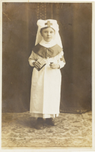 A 1917 postcard featuring a little girl dressed as an Anzac nurse